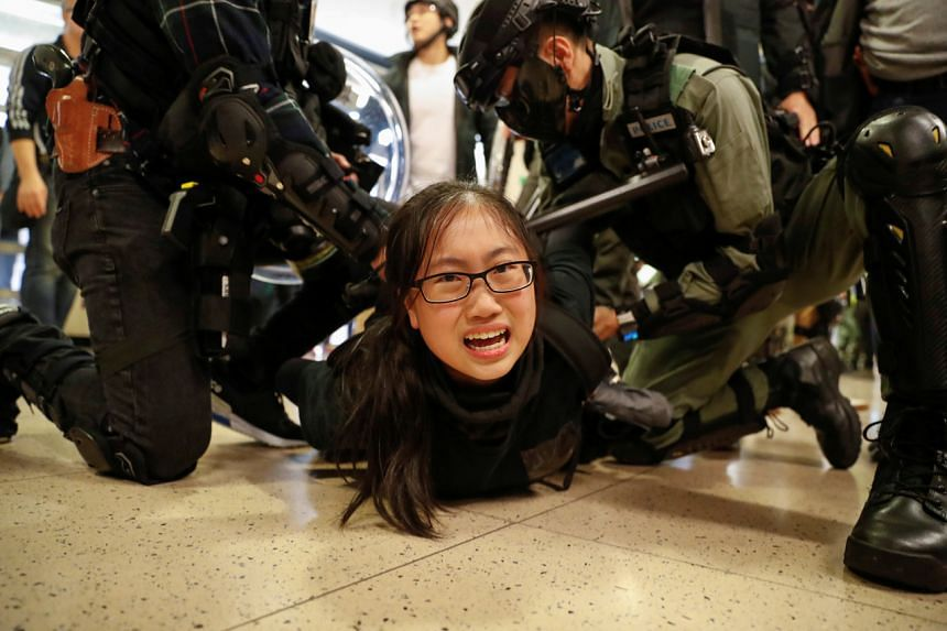 Police detain a protester during a demonstration inside a mall in Hong Kong on Dec 15, 2019.