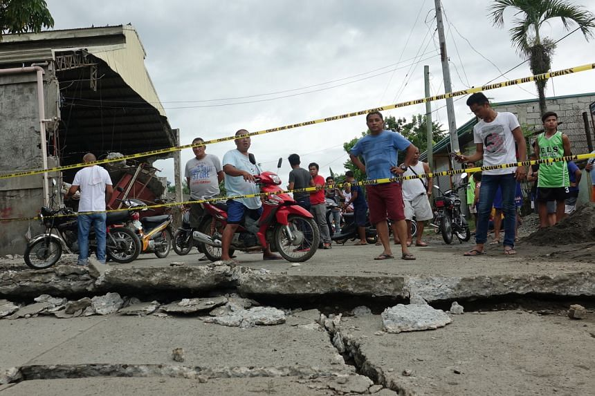 A damaged road in the quake-hit town of Padada, in the Philippines' Davao Del Sur province, on Dec 15, 2019.