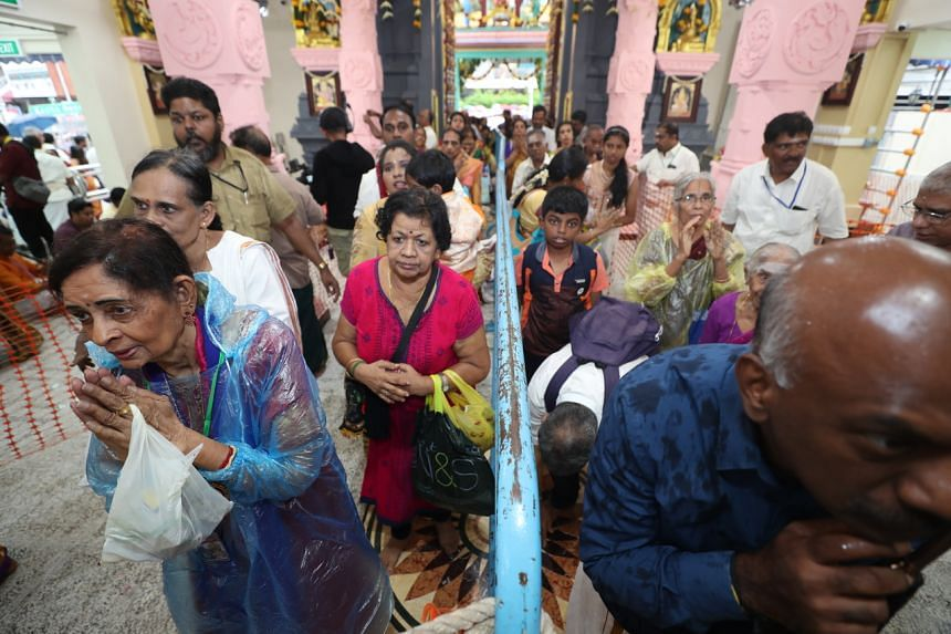 Devotees praying in the newly consecrated sanctum of the Sri Layan Sithi Vinayagar Temple.