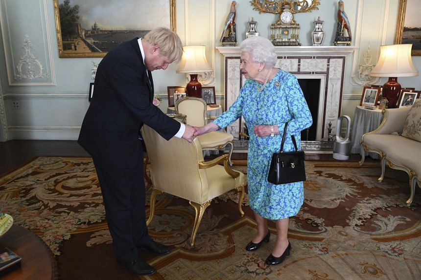 In a photo taken on July 24, 2019, Britain's Queen Elizabeth II welcomes Prime Minister Boris Johnson during an audience at Buckingham Palace in London.