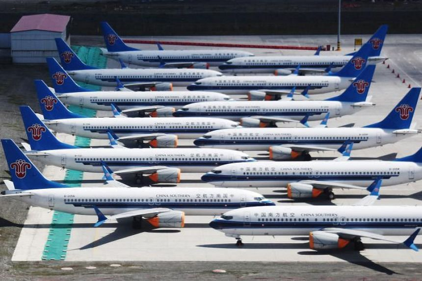 Grounded China Southern Airlines Boeing 737 Max aircraft parked in a line at Urumqi airport, in China's western Xinjiiang region, on June 5, 2019.