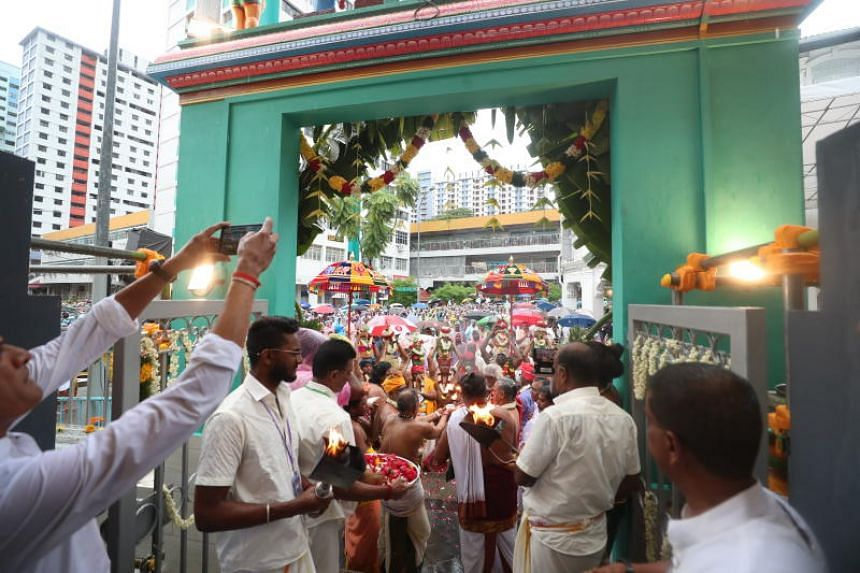 Devotees take part in the procession before the consecration ceremony that marked the re-energising of the Sri Layan Sithi Vinayagar Temple and its deity within on Dec 15, 2019.