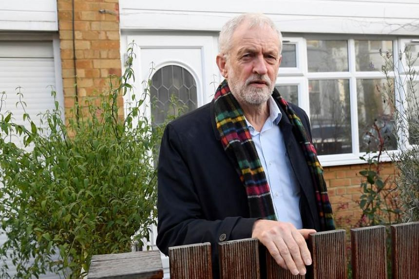 Britain's main opposition leader Jeremy Corbyn apologised to supporters but defended his far-left campaign platform.