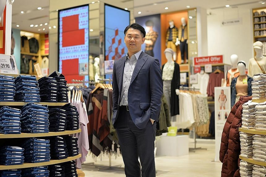 Mr Yuki Yamada, chief executive for Uniqlo Singapore and Malaysia, at the Japanese clothes retailer's flagship outlet in Orchard Central. The company is opening a new store soon, adding to its 28 outlets here.
