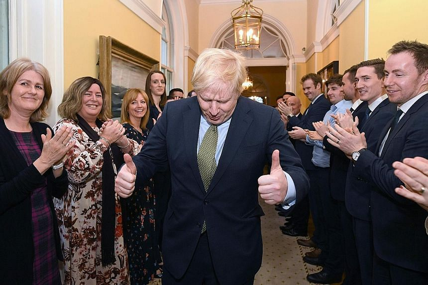 British Prime Minister Boris Johnson being greeted by staff at No. 10 Downing Street last Friday, following an audience with Queen Elizabeth. In a speech to Parliament on Thursday, the Queen will lay out the government's domestic agenda and much of i