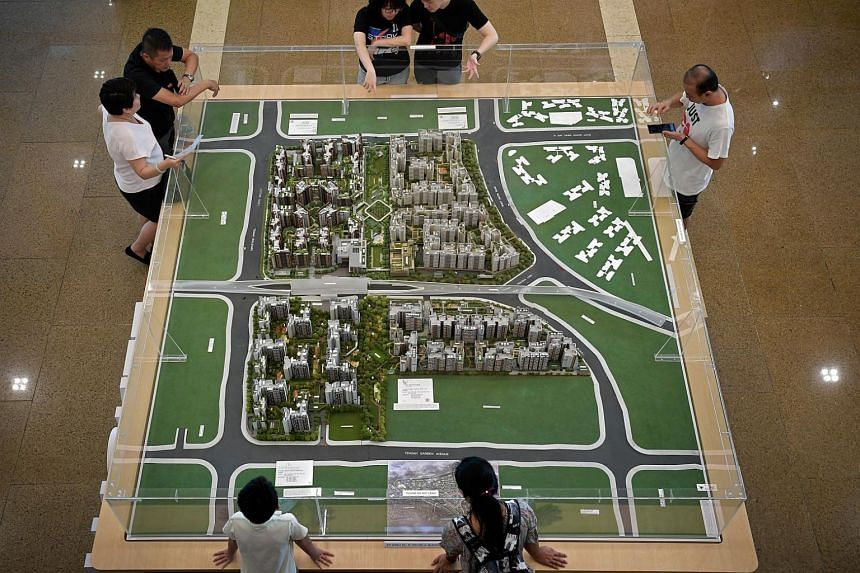 Potential home-buyers looking at a model of flats at HDB Hub in Toa Payoh, on Dec 12, 2019.