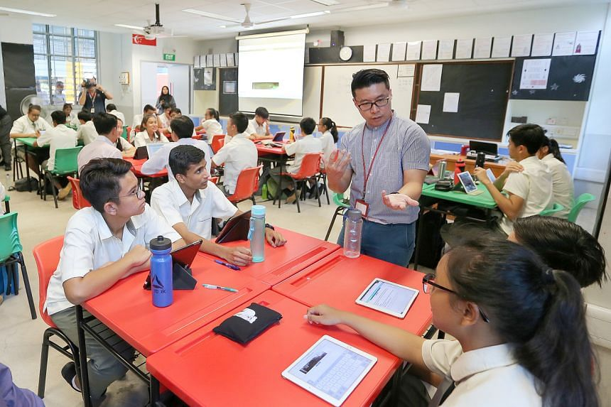 In a photo taken on Aug 16, 2017, social studies teacher Tay Peiyong interacts with his students from Admiralty Secondary School.