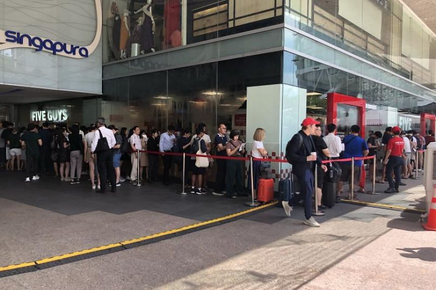 The first person started queueing from 4am, says a Five Guys Singapore spokesman, and the average queue time was about one hour on Dec 16, 2019.