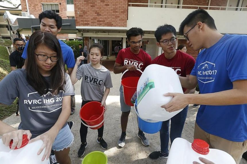 A water rationing exercise at NUS Ridge View Residential College last year. More people in Singapore are saving water, according to a climate change perception survey this year, compared with 2017.