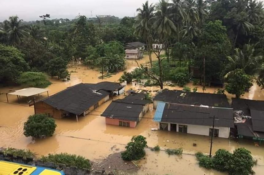 A view of the flooding at a village in Skudai, Johor. Torrential rain is forecast today for the state, as well as Terengganu and Pahang. The number of people evacuated in Johor was 9,348 as of yesterday.