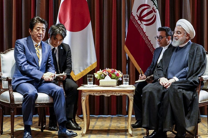 A handout photo on Sept 24, 2019 shows Japanese Prime Minister Shinzo Abe (left) and Iranian President Hassan Rouhani meeting on the sidelines of the 74th United Nations General Assembly in New York.