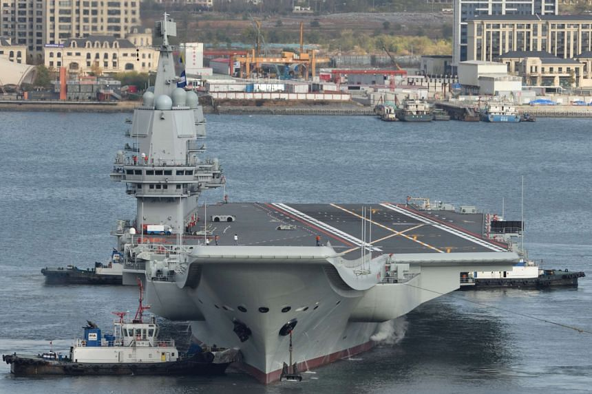 China's first domestically built aircraft carrier departs the port for its ninth sea trial in Dalian, China, on Nov 14, 2019.
