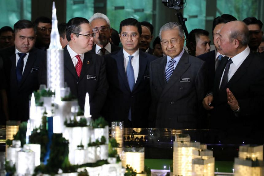 (From left) Malaysia's Transport Minister Anthony Loke Siew Fook, Finance Minister Lim Guan Eng, Economic Affairs Minister Azmin Ali and Prime Minister Mahathir Mohamad look at the model of Bandar Malaysia in Putrajaya, on Dec 17, 2019.