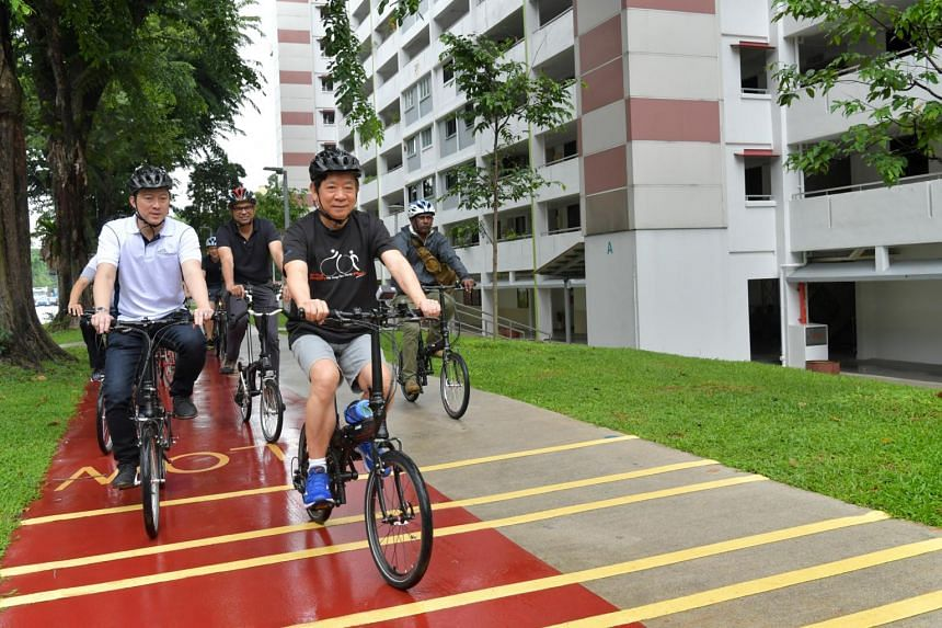 Senior Minister of State for Transport Lam Pin Min, Transport Minister Khaw Boon Wan and Senior Minister of State for Transport Janil Puthucheary cycling a 5km-long route in Ang Mo Kio on Dec 17, 2019.