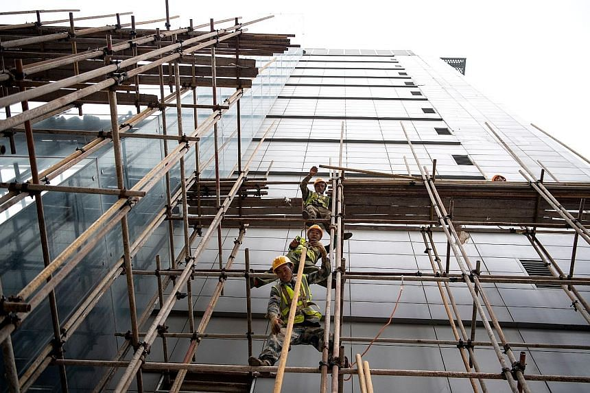 A construction site in Beijing. Technology firms are playing a greater role in driving up rents for premium offices than the traditional banking and financial services industry, especially in innovation-rich cities like Beijing, Singapore and Tokyo.