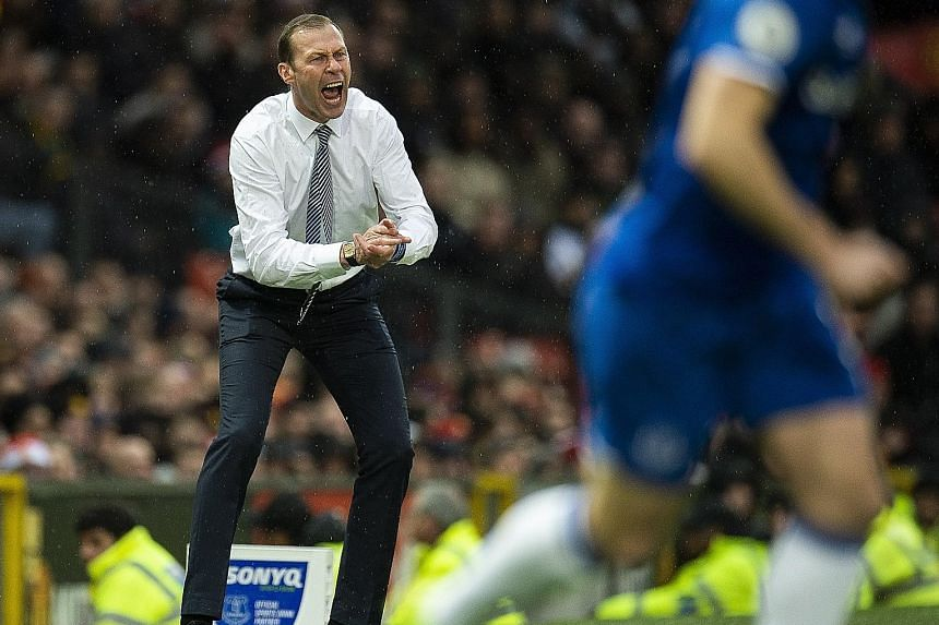 An animated Duncan Ferguson rousing his Everton players during the 1-1 draw at Old Trafford on Sunday. The Scot will likely be in charge of one more match before Carlo Ancelotti takes over, according to reports yesterday.