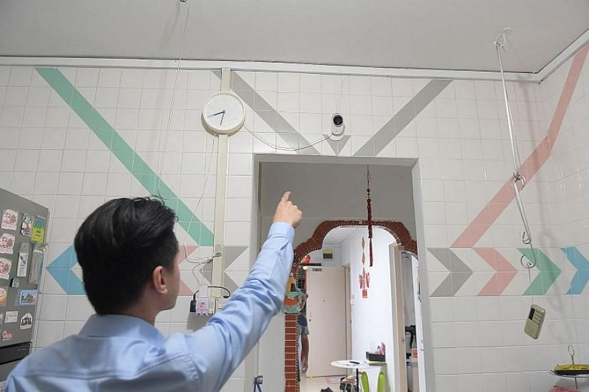 Mr Daniel See, 29, pointing to a closed-circuit television camera.