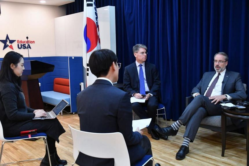 US negotiator for defence cost-sharing James DeHart (right), meets reporters after holding Special Measures Agreement talks with South Korean counterparts in Seoul on Dec 18, 2019.