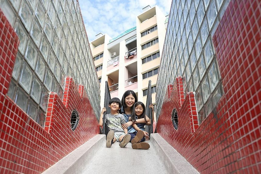 Mother Hen Club volunteer Amanda Lim, 35, with her son Kalen Neo, five, and daughter Kalyn Neo, seven. The initiative offers temporary care services to mothers or families in need.
