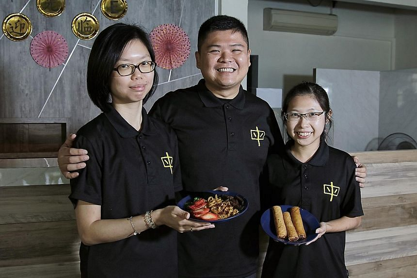 Mummy Yummy staff who are also family members of the founders, (from far left) Ms Cheng Yihui, 28, Mr Chan Guo Xiong, 35, and Ms Ang Hwee Shi, 25, with dishes they serve at their vegetarian restaurant at 20 Jalan Pari Burong in Bedok.