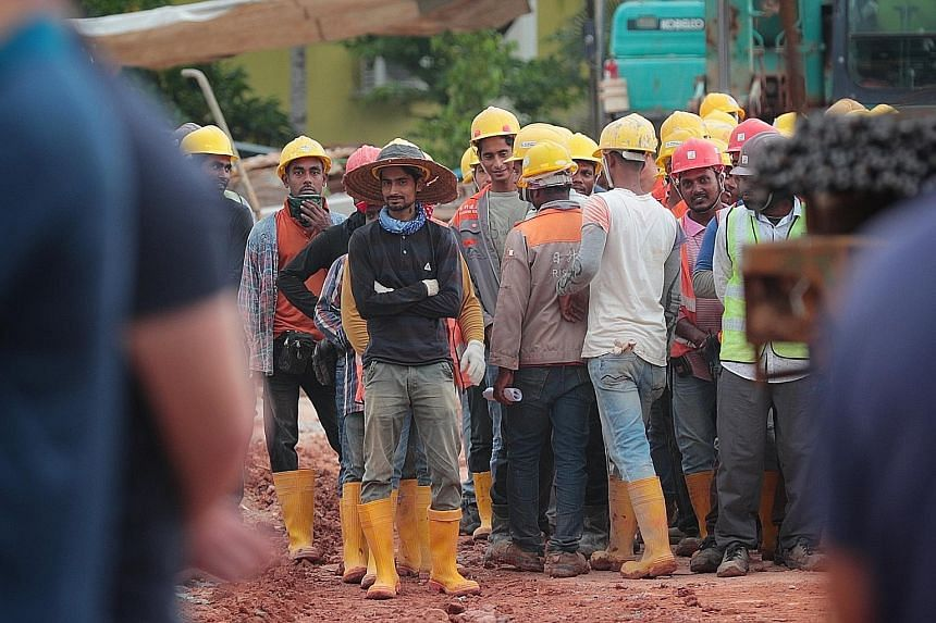 Sixty per cent of those surveyed here felt that migrant workers should not receive the same pay benefits as local workers, the highest share out of the four nations surveyed. ST PHOTO: JASON QUAH