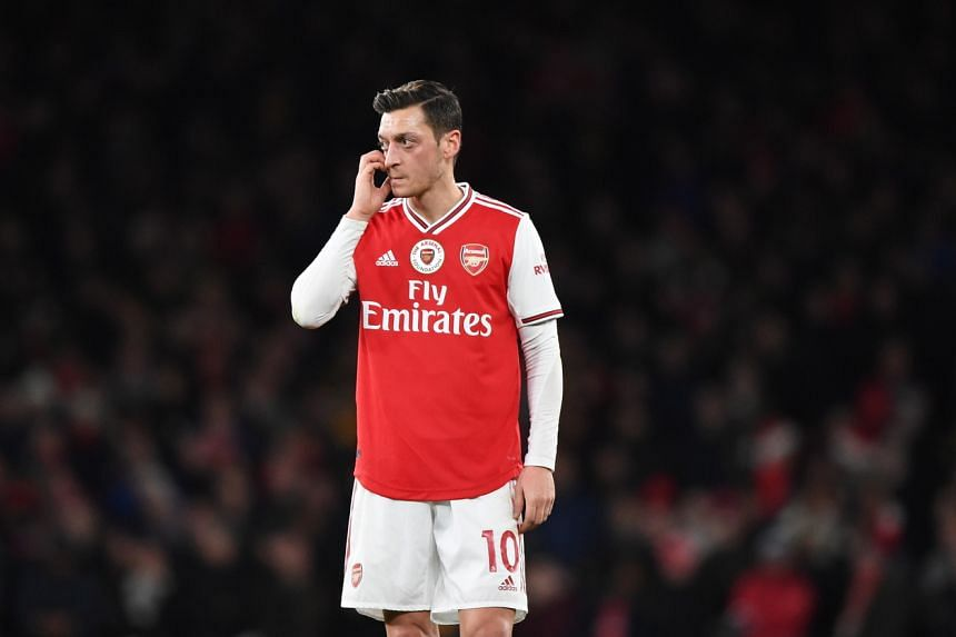 """US-listed Chinese internet company NetEase said it removed Arsenal midfielder Mesut Ozil from the Pro Evolution Soccer mobile game due to his """"extreme comment about China""""."""