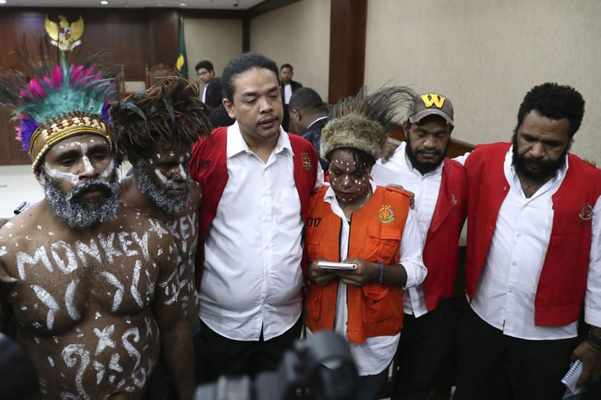 (From left) Papuan independence activists Anes Tabuni, Ambrosius Mulait, Suryanta Ginting, Arina Elopere, Isay Wenda, and Charles Kossay attend their trial at Central Jakarta District Court in Jakarta on Dec 19, 2019.