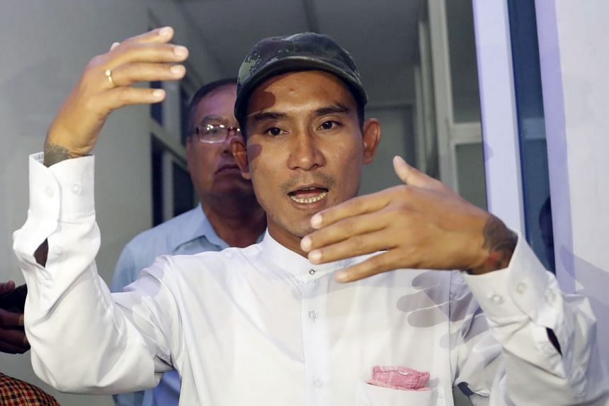 Aung Kyaw Myo talks to the media after being released outside a court in Naypyitaw.