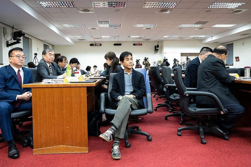 BreadTalk group executive chairman and founder George Quek (centre) attending a conference on the dispute over the ownership of Pacific Distribution Investment at the Legislative Yuan in Taipei on Wednesday.