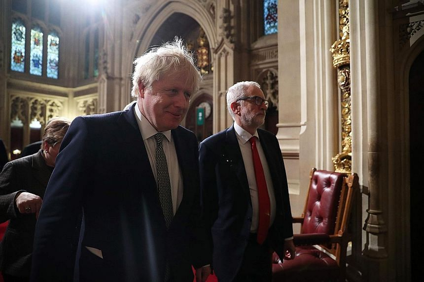 Prime Minister Boris Johnson (left) and Labour Party leader Jeremy Corbyn on the way to listen to Queen Elizabeth II's speech. PHOTO: AGENCE FRANCE-PRESSE Queen Elizabeth II and Prince Charles walking through the Royal Gallery before the monarch deli