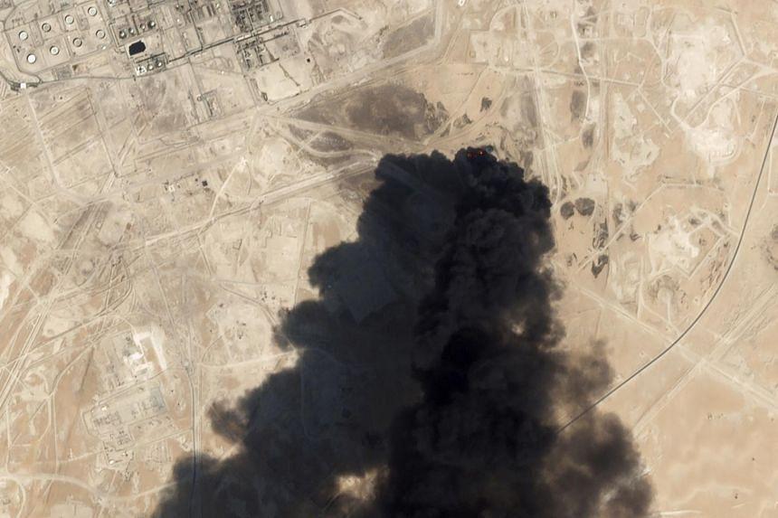Thick black smoke rising from Saudi Aramco's Abqaiq oil processing facility in Buqyaq, Saudi Arabia, on Sept 14, 2019.