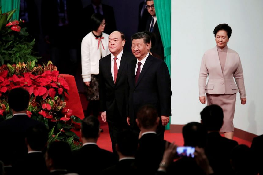 Chinese President Xi Jinping (right) and Macau's new Chief Executive Ho Iat Seng at a ceremony to inaugurate the fifth-term government of the Macau Special Administrative Region, on Dec 20, 2019.
