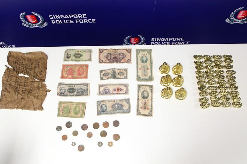 Items including old notes and fake gold ingots showcased during a media interview with a victim of a gold ingot scam, held at the Police Headquarters at New Phoenix Park.