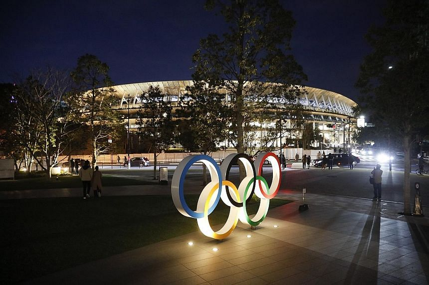 The Olympic rings in front of the new National Stadium in Tokyo. Due to overwhelming demand, most Japanese will not get to watch live events at the Games which they are helping to fund via taxes.