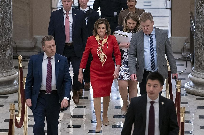 """Senate Majority Leader Mitch McConnell returning to his office after a speech on the Senate floor of the Capitol in Washington on Thursday. He called the House process on the impeachment """"slapdash"""". US House Speaker Nancy Pelosi, seen at the Capitol"""