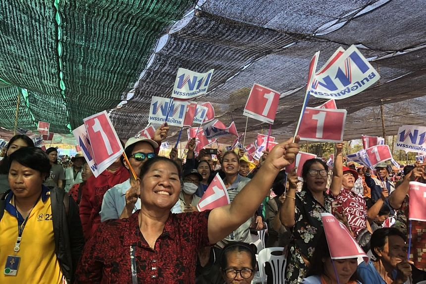Pheu Thai Party's Khon Kaen candidate, Mr Thanik Maseepitak, thanking his supporters at a campaign event in Nong Ruea district on Thursday. Pheu Thai Party supporters at a campaign event on Thursday in Nong Ruea district, Khon Kaen. Their candidate,