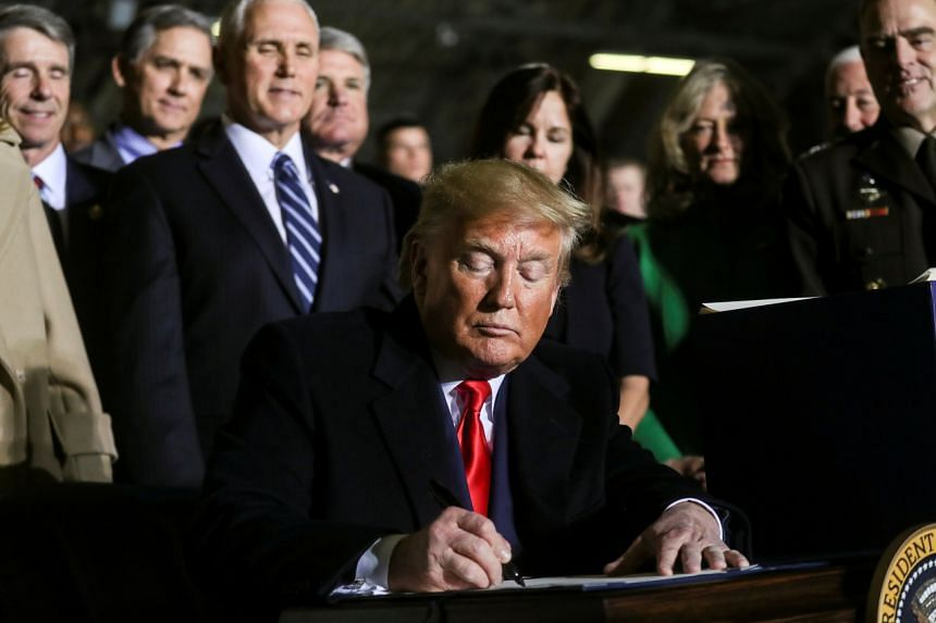 """US President Donald Trump signs the """"National Defense Authorization Act for Fiscal Year 2020"""" in US on Dec 20, 2019."""