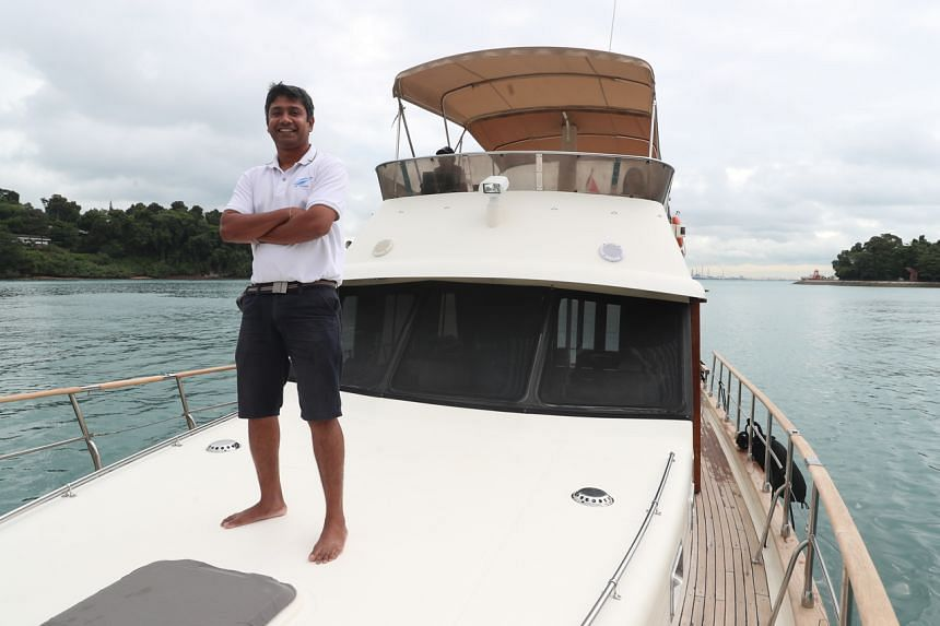 Mr Kogu Segaran on board the Le Tara, which is furnished like a cosy apartment with bedrooms, a kitchenette and a living area.