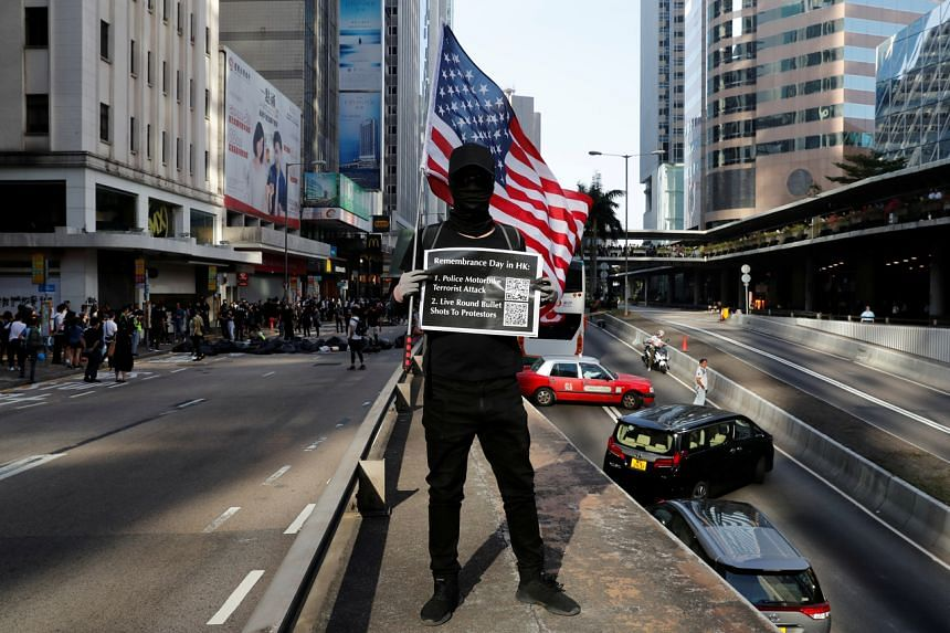 A photo taken on Nov 11, 2019, shows a protester in Hong Kong's Central district.