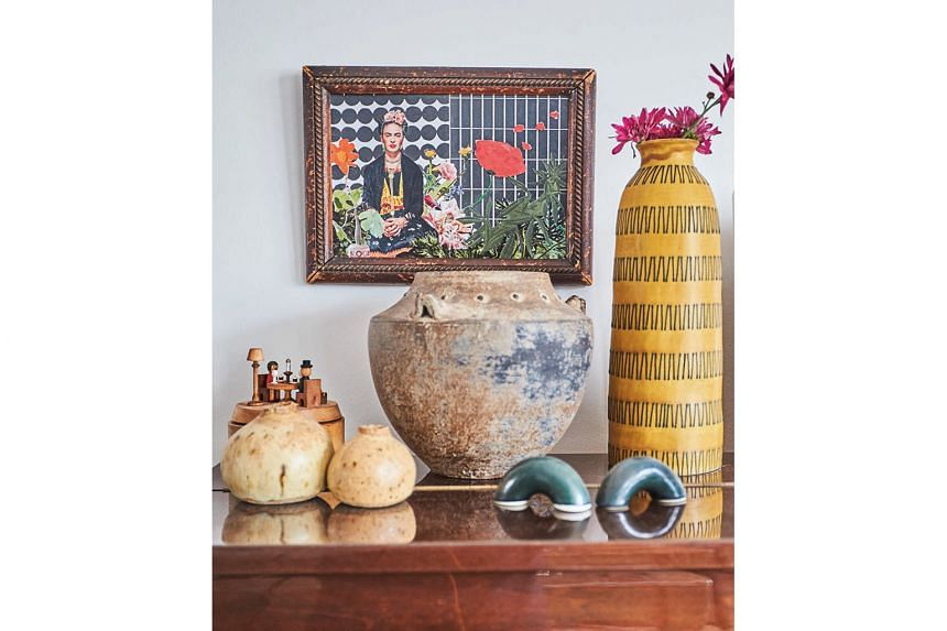 The flat is adorned with the couple's own artworks, gifts from friends and quirky finds from their travels (above).