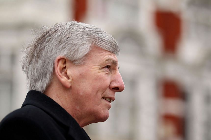 A 2013 photo shows Martin Peters during a wreath laying ceremony to mark the 20th anniversary of Bobby Moore's death.