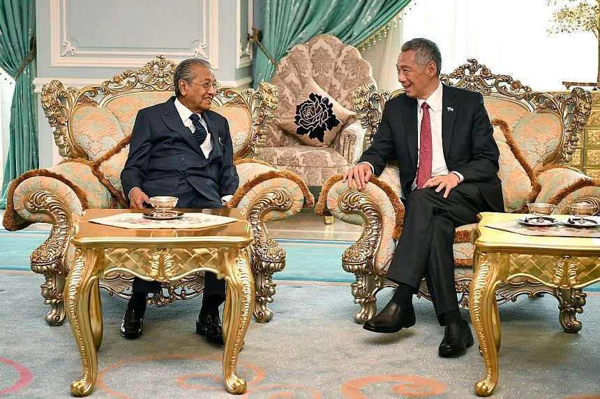 PM Lee with Malaysian Prime Minister Mahathir Mohamad at the ninth Malaysia-Singapore Leaders' Retreat in April in Putrajaya. It was the two leaders' first such retreat together as heads of government.