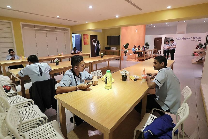 Having clean and well-equipped rest areas for outsourced workers helps to better motivate and retain staff, said cleaning companies that The Sunday Times spoke to. Above: Outsourced workers in the rest area of Academia at Singapore General Hospital.