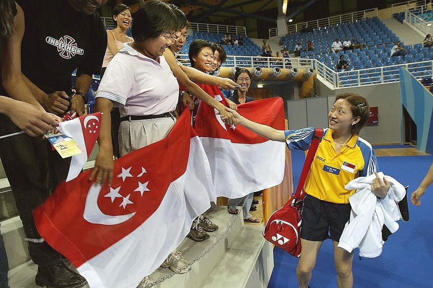 The 55,000-capacity stadium at the $1.33 billion Singapore Sports Hub has the largest retractable dome roof in the world. Singapore netballer Aqilah Andin playing in the SEA Games final with Malaysia's players on Dec 2. Singapore lost this match, but