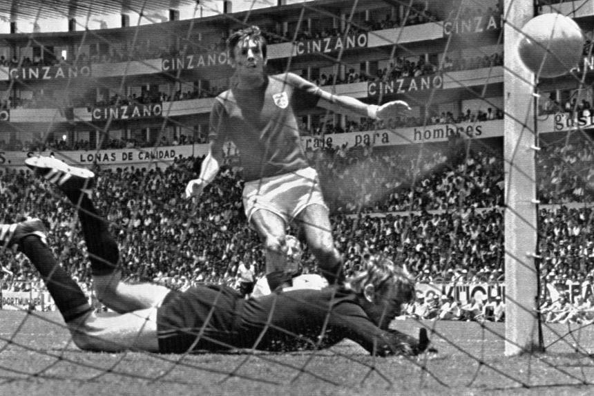 A 1970 photo shows Peters scoring England's second goal in the world cup quarter-final against West Germany.