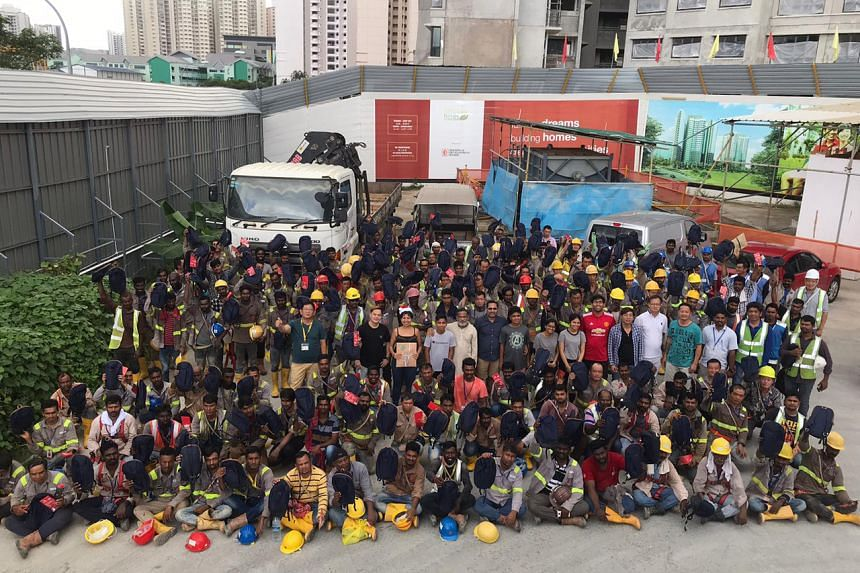 Some 200 Christmas gifts were given out to workers at Fernvale Lane on Saturday (Dec 21) as part of ItsRainingRaincoats' gift donation drive for migrant workers.