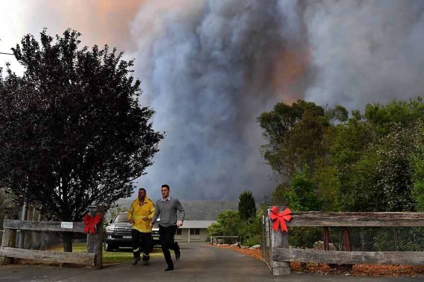 Smoke from the Green Wattle Creek Fire is seen in the south-west of Sydney on Dec 19, 2019.