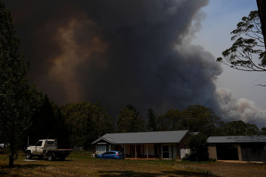 A home is seen as smoke from the Grose Valley Fire rises in the distance in Bilpin, near Sydney, on Dec 21, 2019.