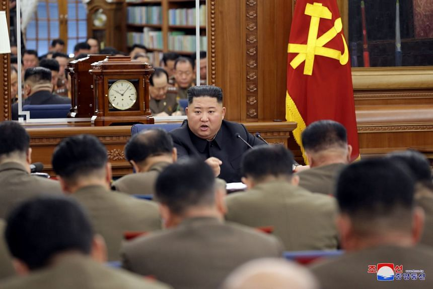 North Korean leader Kim Jong Un speaks during an enlarged meeting of the ruling Workers' Party's Central Military Commission in this photo released by KCNA on Dec 21, 2019.
