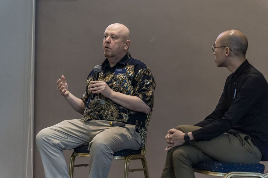 Dr Iain Sinclair (left), who has been studying the Singapore Stone, suggested it could have been created at the beginning of the 11th century.